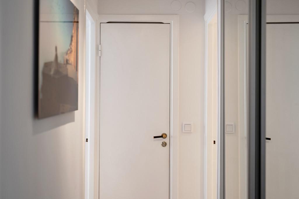 Korridor med  skjutdörrsgarderober