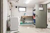 En av två tvättstugor i källaren